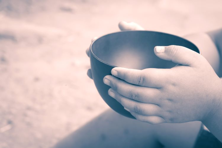 Small hands empty bowl