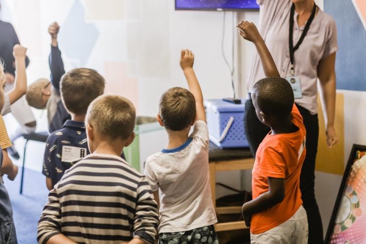 School kids raising hands
